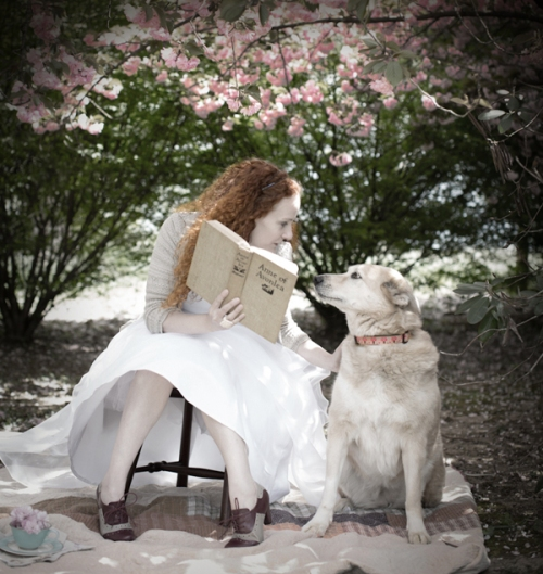 (Karen's caption): My favorite photo of me with Grandma Small's book, reading to my friend's dog, Lola.
