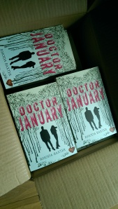 A box of author copies of Doctor January in paperback.