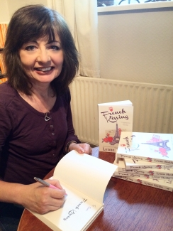 Lynne Shelby with her debut novel French Kissing